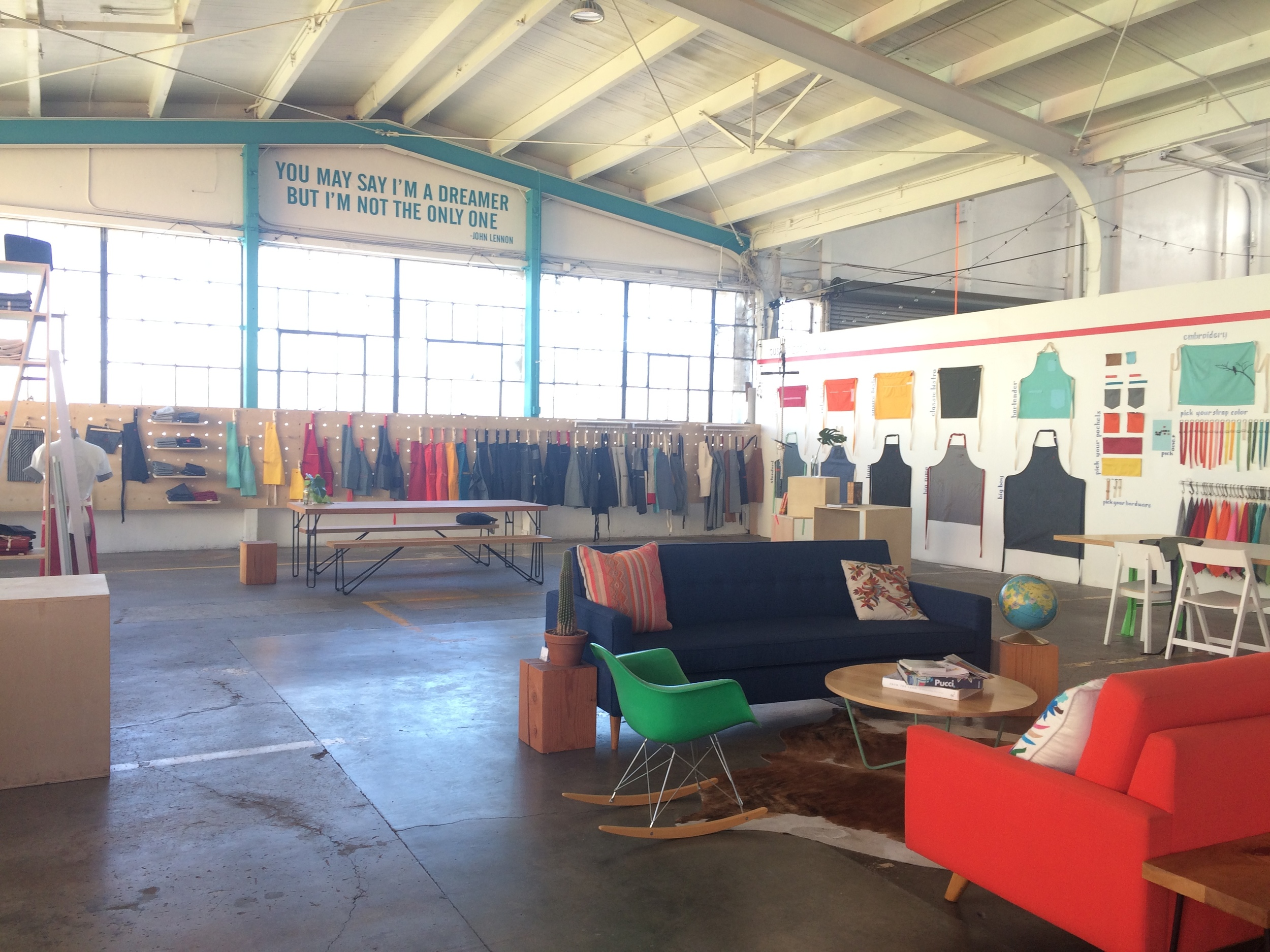 Inside the  hedley & bennett  apron studio. Colorful and charming!