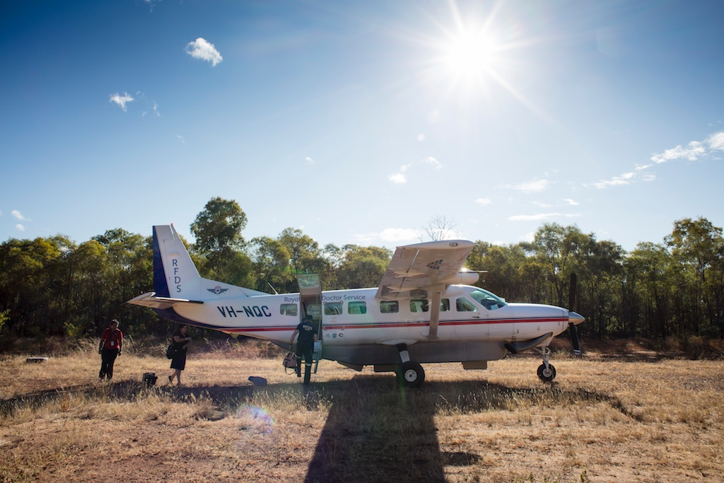 Royal Flying Doctor Service Clinic at Gilberton Station, Qld... RFDS Pilot Ross Thomas loading the aircraft for departure from the station