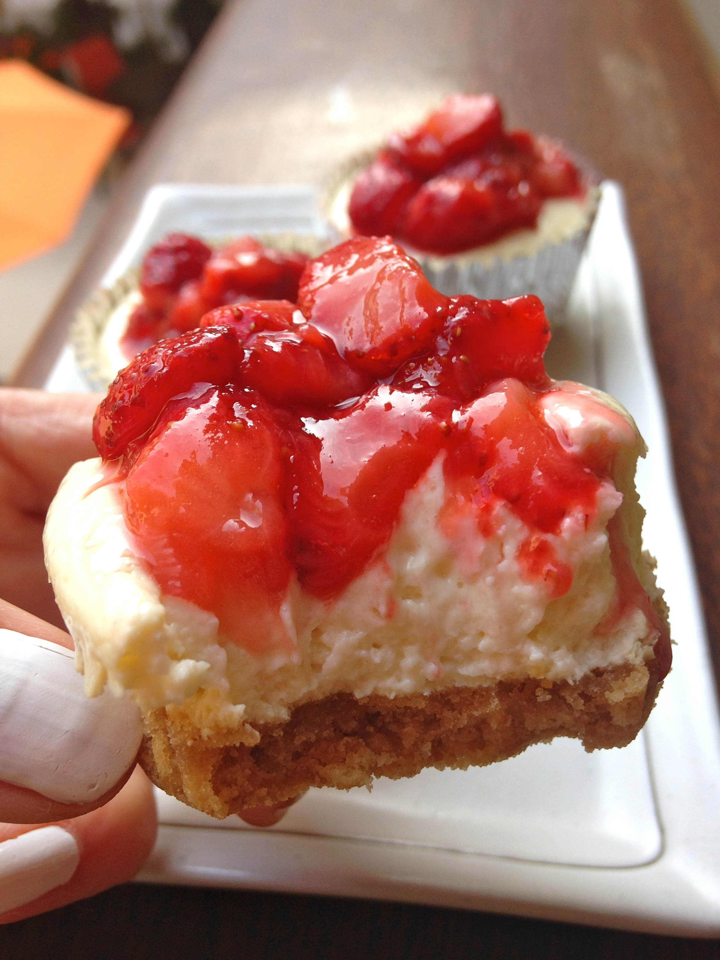 bite of mini strawberry cheesecake