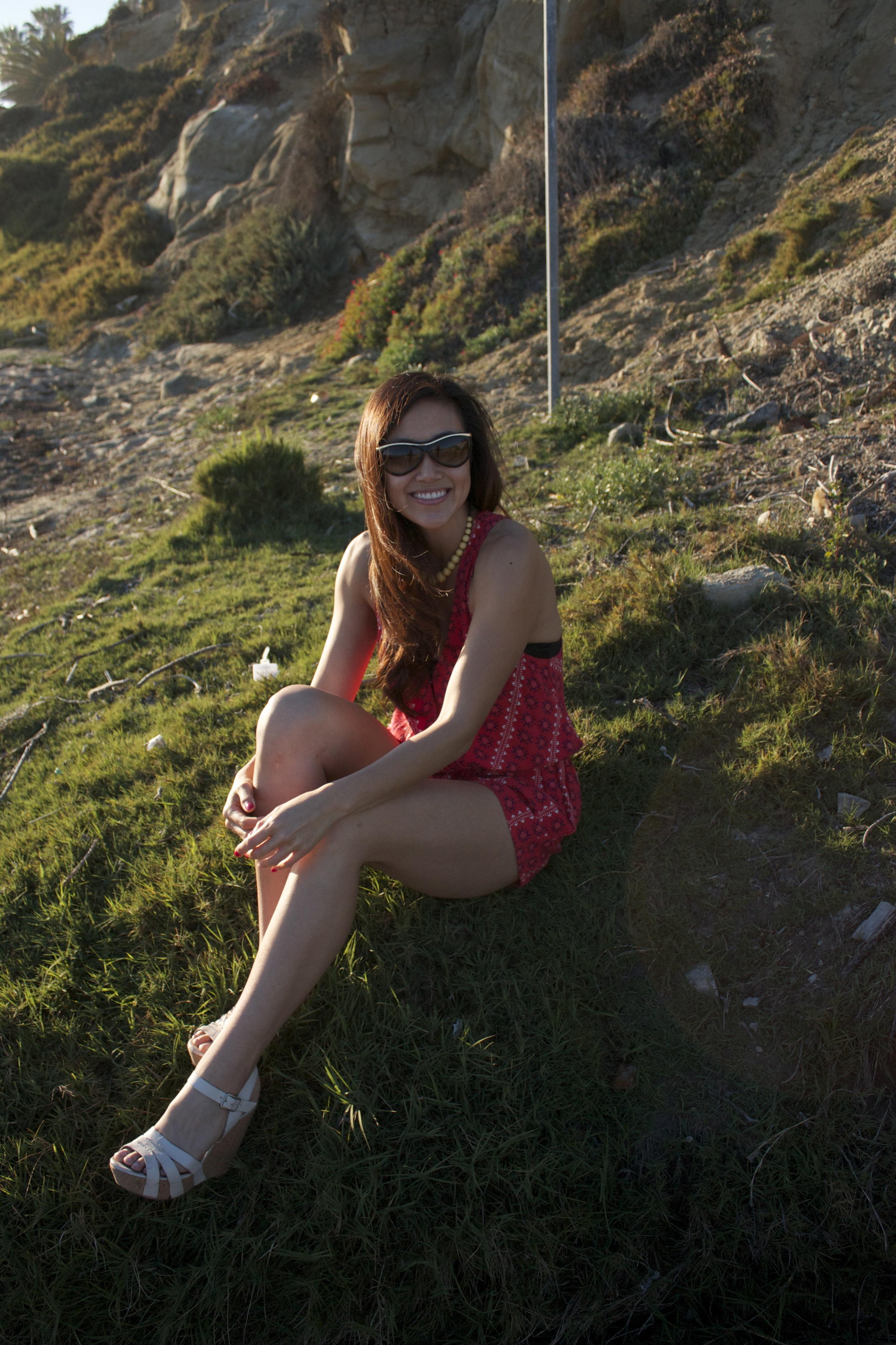 sitting in red romper