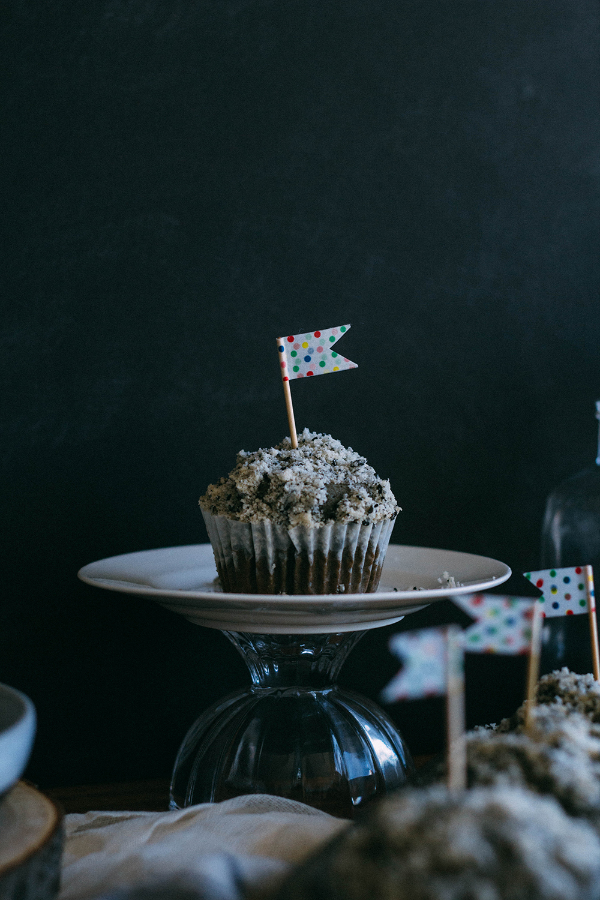 black sesame muffin on cake stand