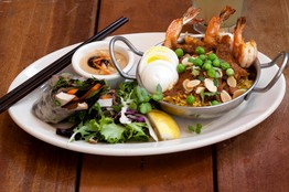 Chicken and shrimp biryani baked with peas, toasted almonds, egg and cilantro.
