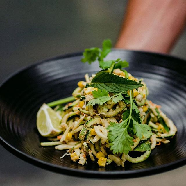 RAW PAD THAI || Made with fresh zucchini noodles, almond satay sauce, bok choy, Chinese cabbage, corn, tamarind, kaffir lime and mixed sprouts - this delicious main is one of our most popular, satisfying the most hungriest of customers.
