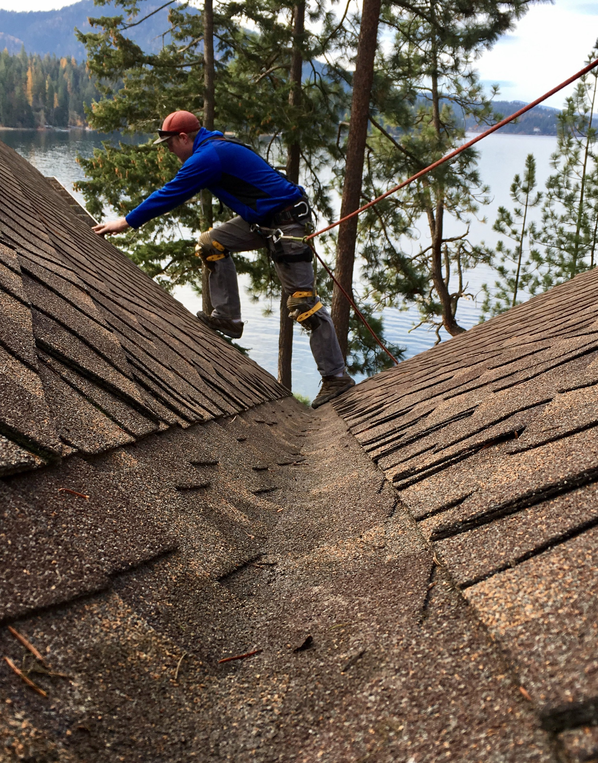 Using fall protection to access hard to reach gutters.