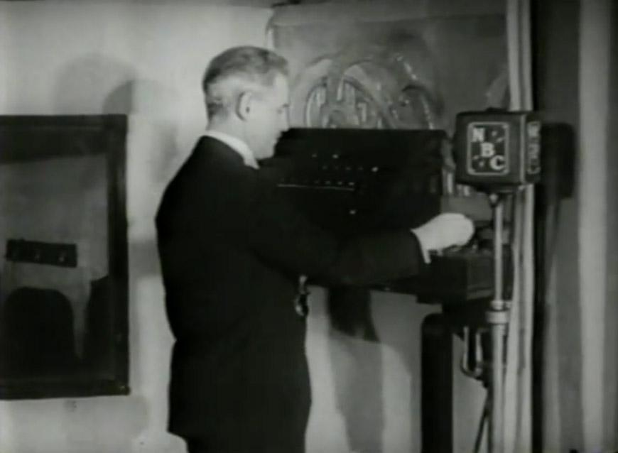 NBC staff announcer strikes the NBC Chimes in 1933