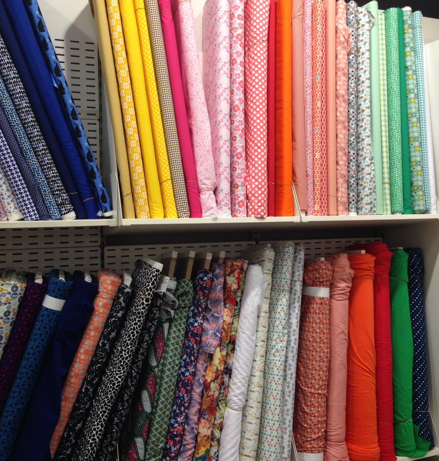 shelves of fabric.JPG