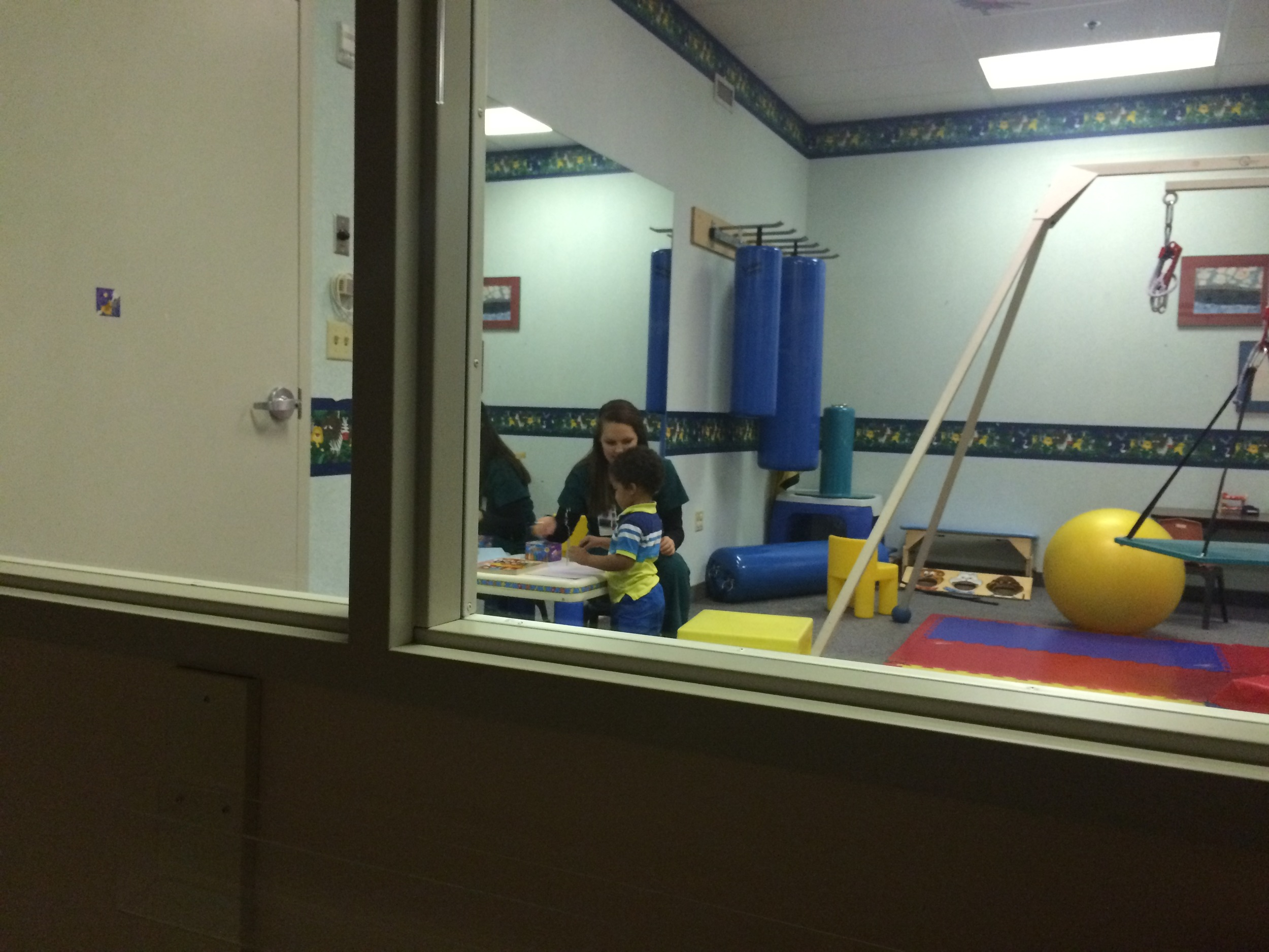 Day 414: I watch Elliott at speech therapy through a one-way mirror