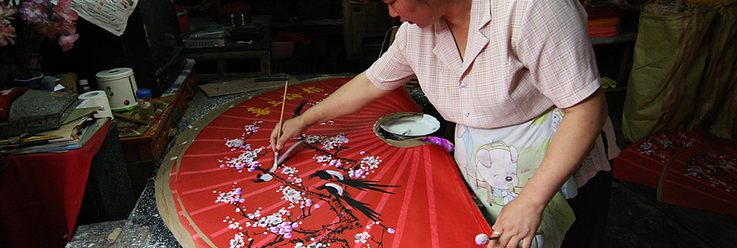 Decorating by hand a wall fan.