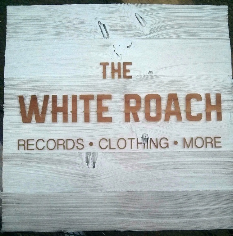 Sandblasted wooden sign for The White Roach