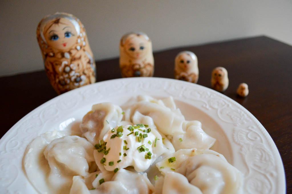 Russian Pelmeni with sour cream and Russian Dolls