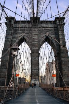 Walk across the Brooklyn Bridge into Manhatten