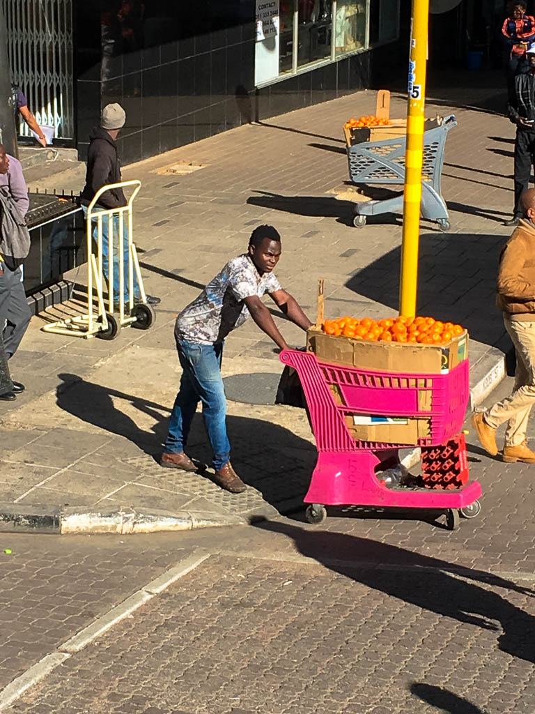 A Hawker selling oranges in JHB