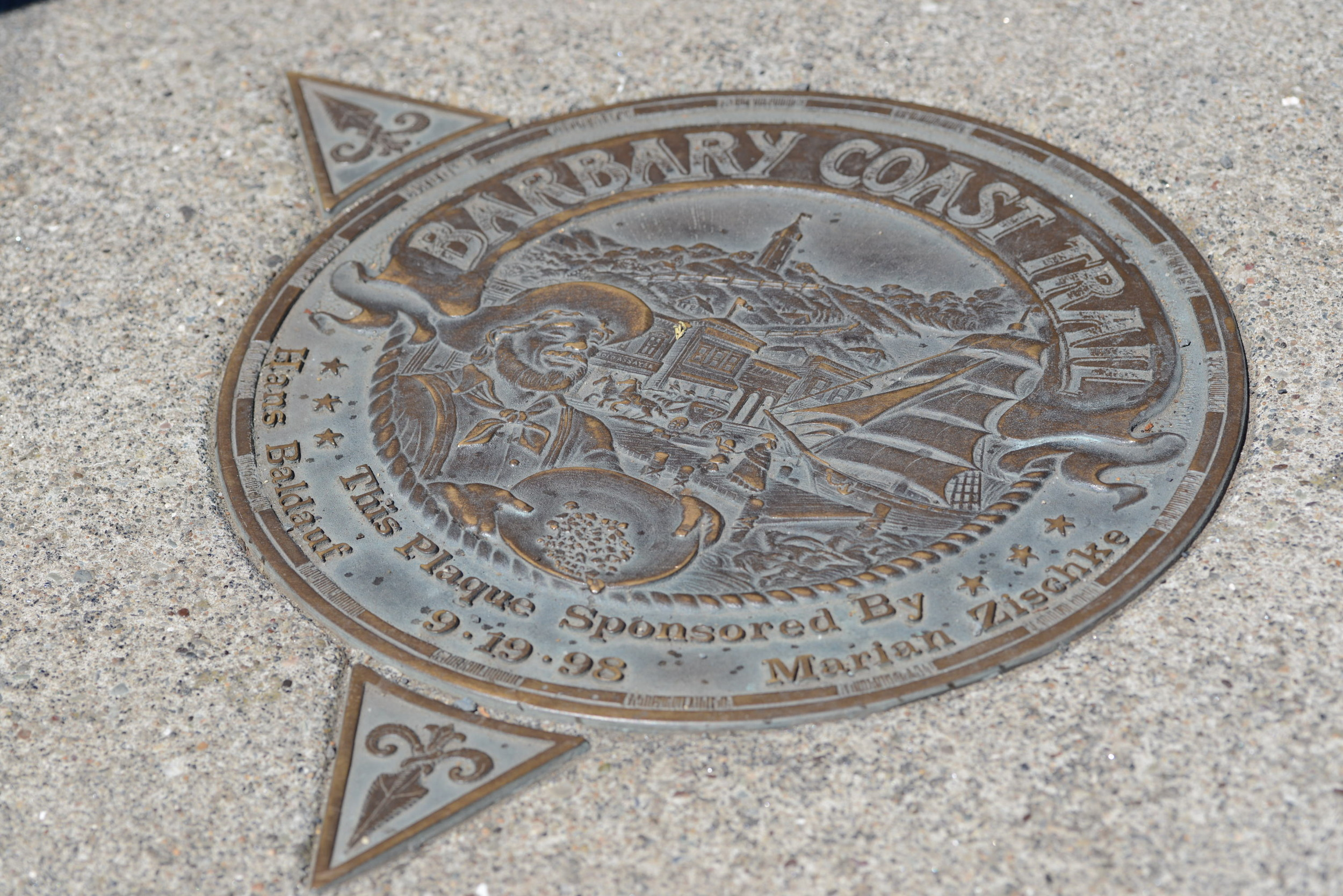 Medallions in the sidewalk indicate which way the trail turns.
