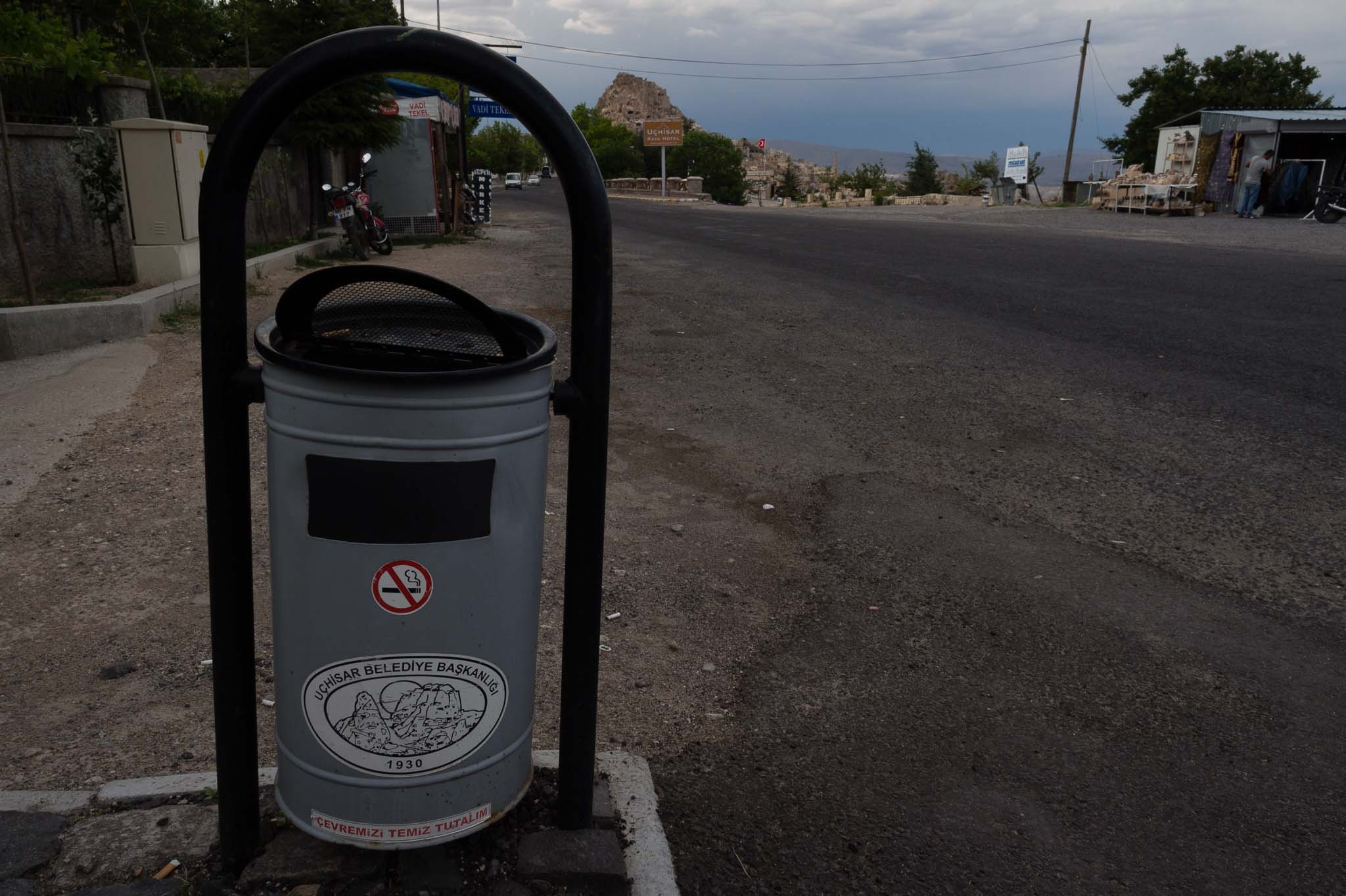 A roadside bin in the Cappadokia region of Central Turkey. Note the cave dwellings in the mountain behind it.