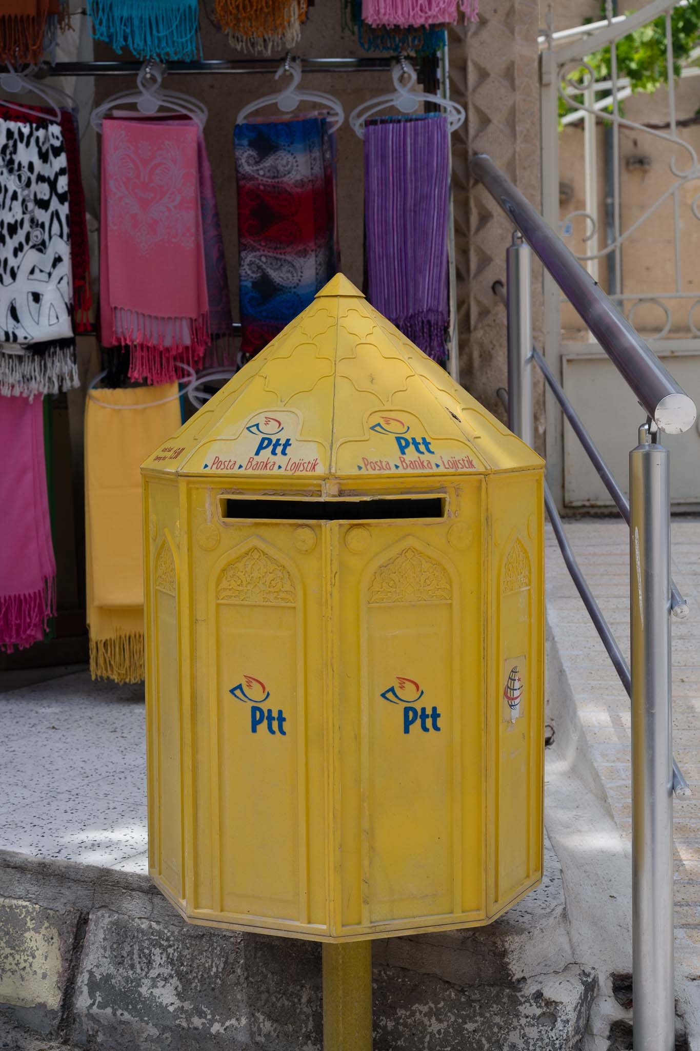 A postal drop box. Not really a bin, unless your letter is rubbish. Colorful nonetheless.