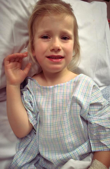 """Post-op Lucy """"smile"""" in hospital"""
