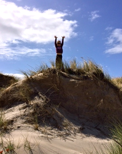 Champion Lucy at the top of a sand dune