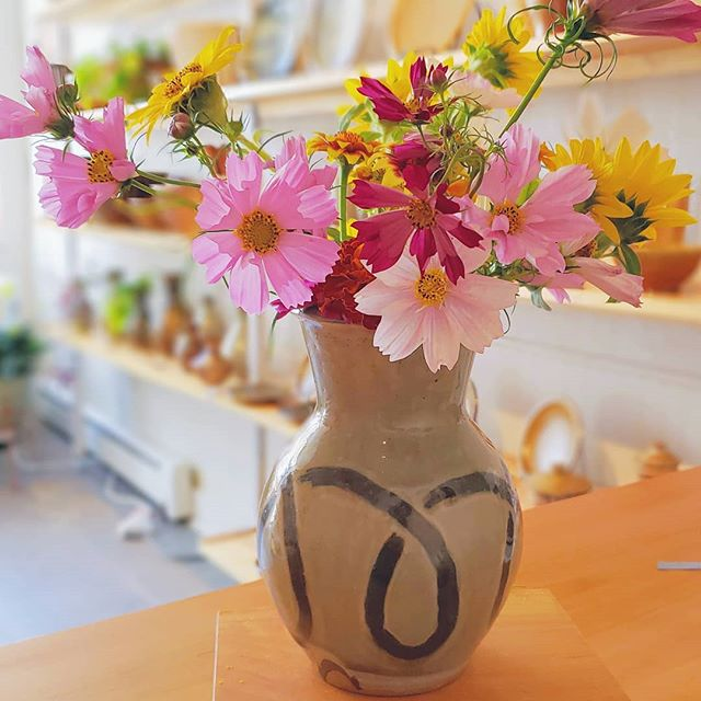 Artfully Mashed Bouquets By Cleo. If you've got flowers,  she will happily fit ALL of them in a vase for you.  #summertime #windyridgepottery #cosmos #sunflower #gallery #artsonpoint #fallarttour #wisconsin #flowers #handmade #homegrown