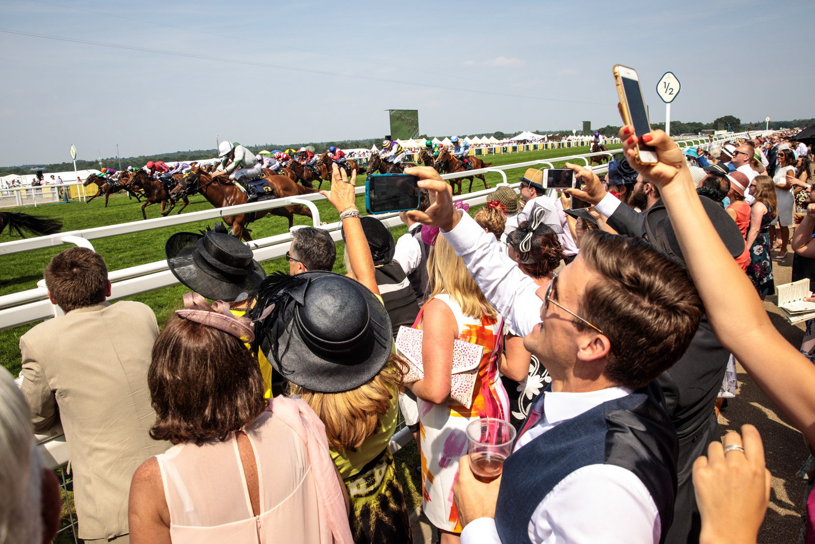 Racegoers take pictures during a race at Royal Ascot 2017 at Ascot Racecourse on June 21, 2017 in Ascot.
