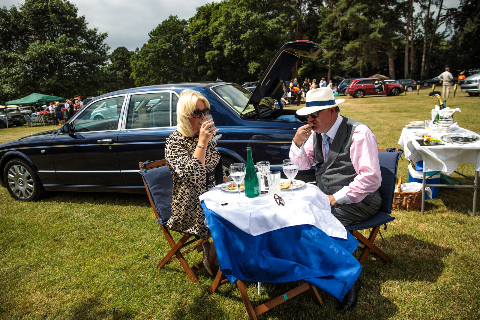 Racegoers eat and drink by their Bentley in a car park on day 3 of Royal Ascot on June 22, 2017 in Ascot.