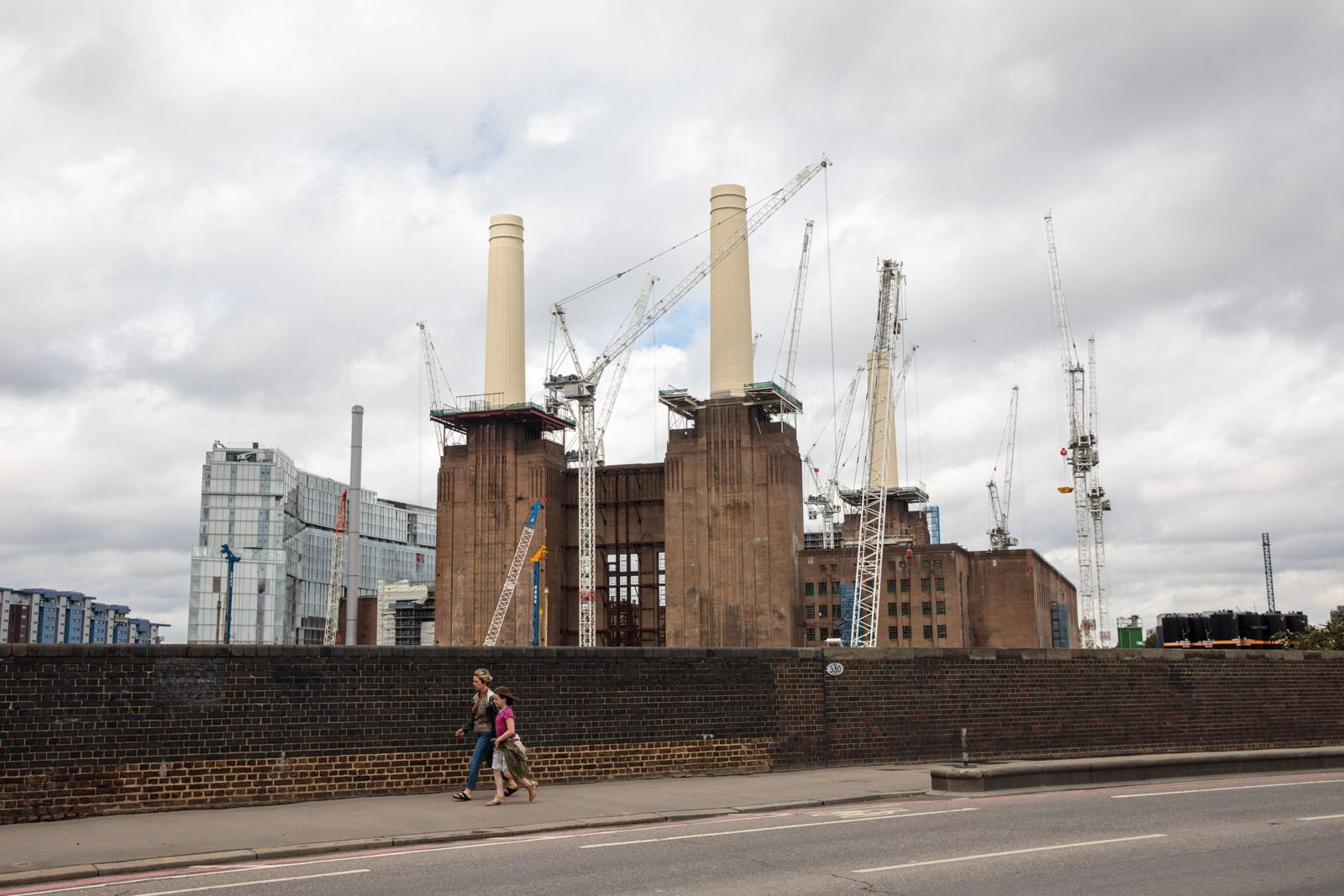 Cranes tower over the Battersea Power Station development July 21, 2017 in London.