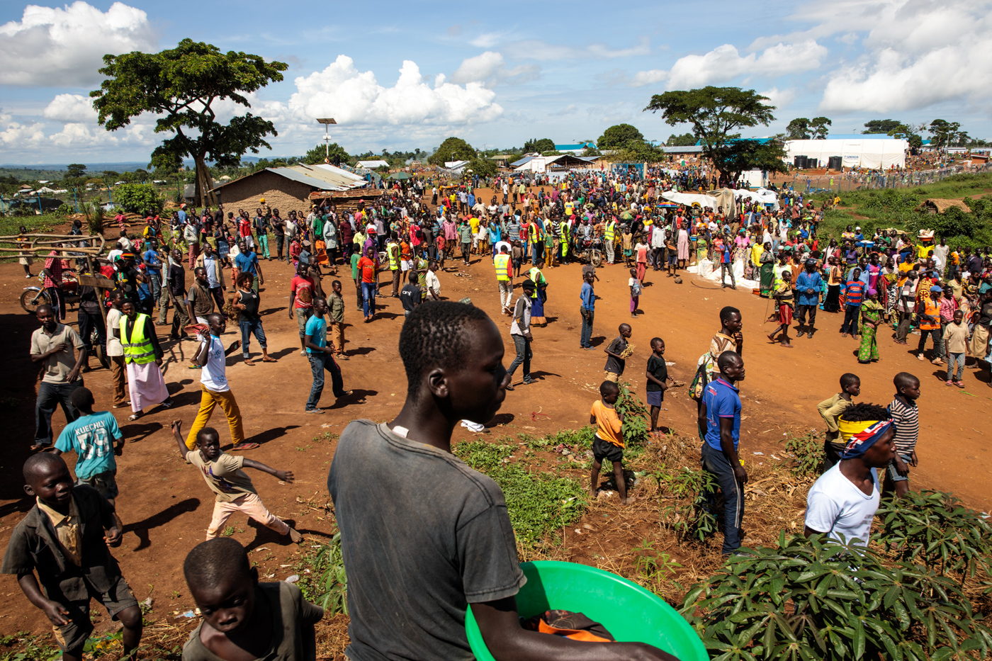 KYANGWALI, UGANDA: Refugees from the Democratic Republic of Congo gather by a market in the Kyangwali Refugee Settlement on April 5, 2018.