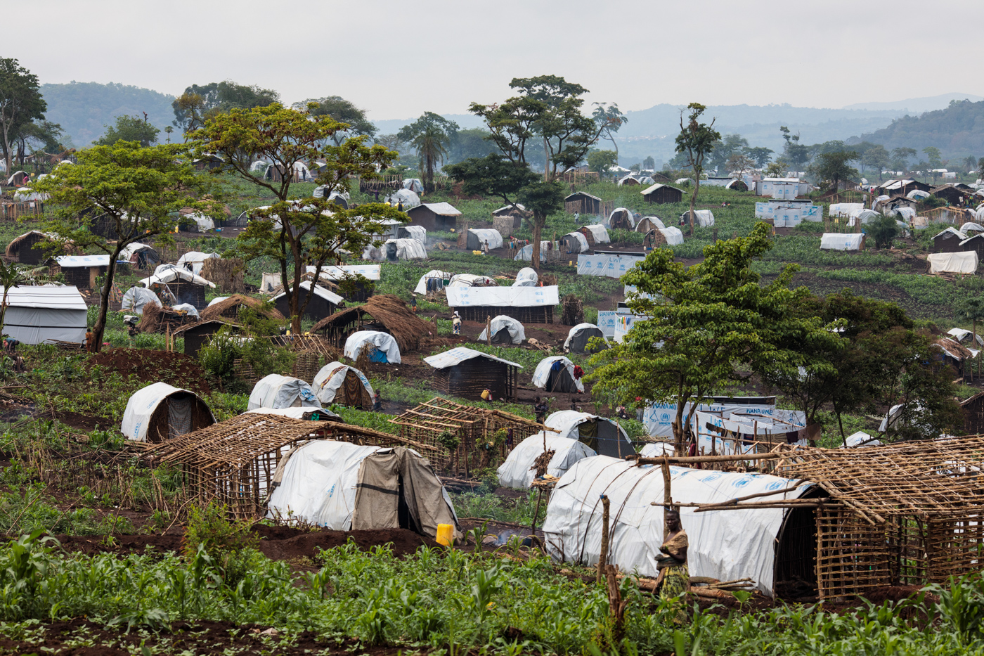 KYANGWALI, UGANDA: Shelters for refugees from the Democratic Republic of Congo stand on a hill in the Kyangwali Refugee Settlement on April 7, 2018.