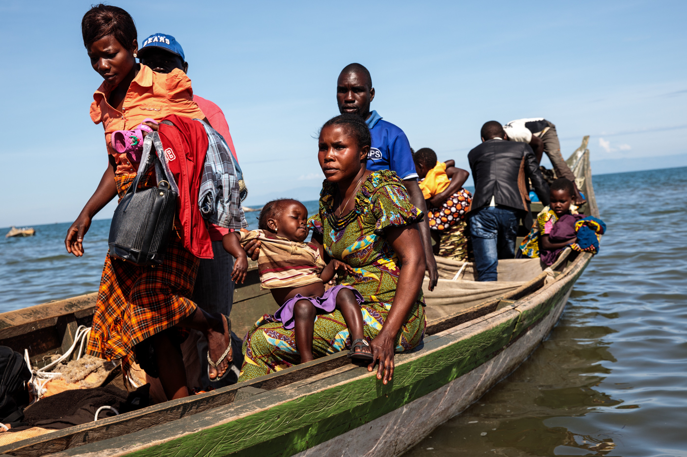 NSONGA, UGANDA: Refugees from Tchomia in the Democratic Republic of Congo arrive on boat at the Nsonga landing site on April 10, 2018.