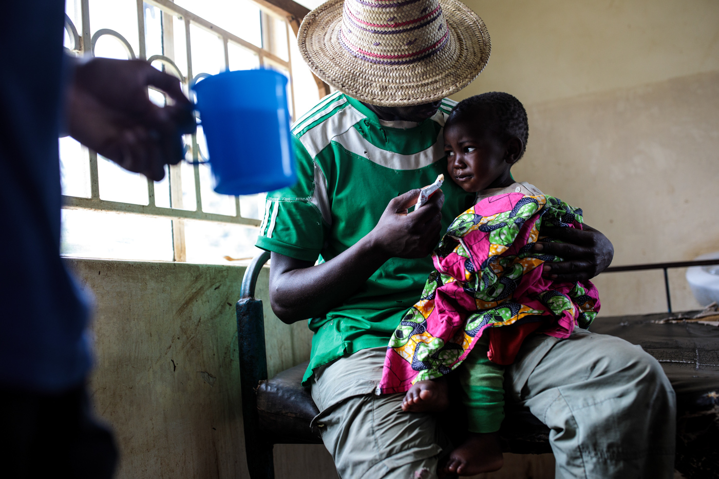 KYANGWALI, UGANDA - APRIL 06: A one-year-old refugee suffering from severe malnutrition is fed by her father at the Rwenyawawa Health Centre in the Kyangwali Refugee Settlement on April 6, 2018.