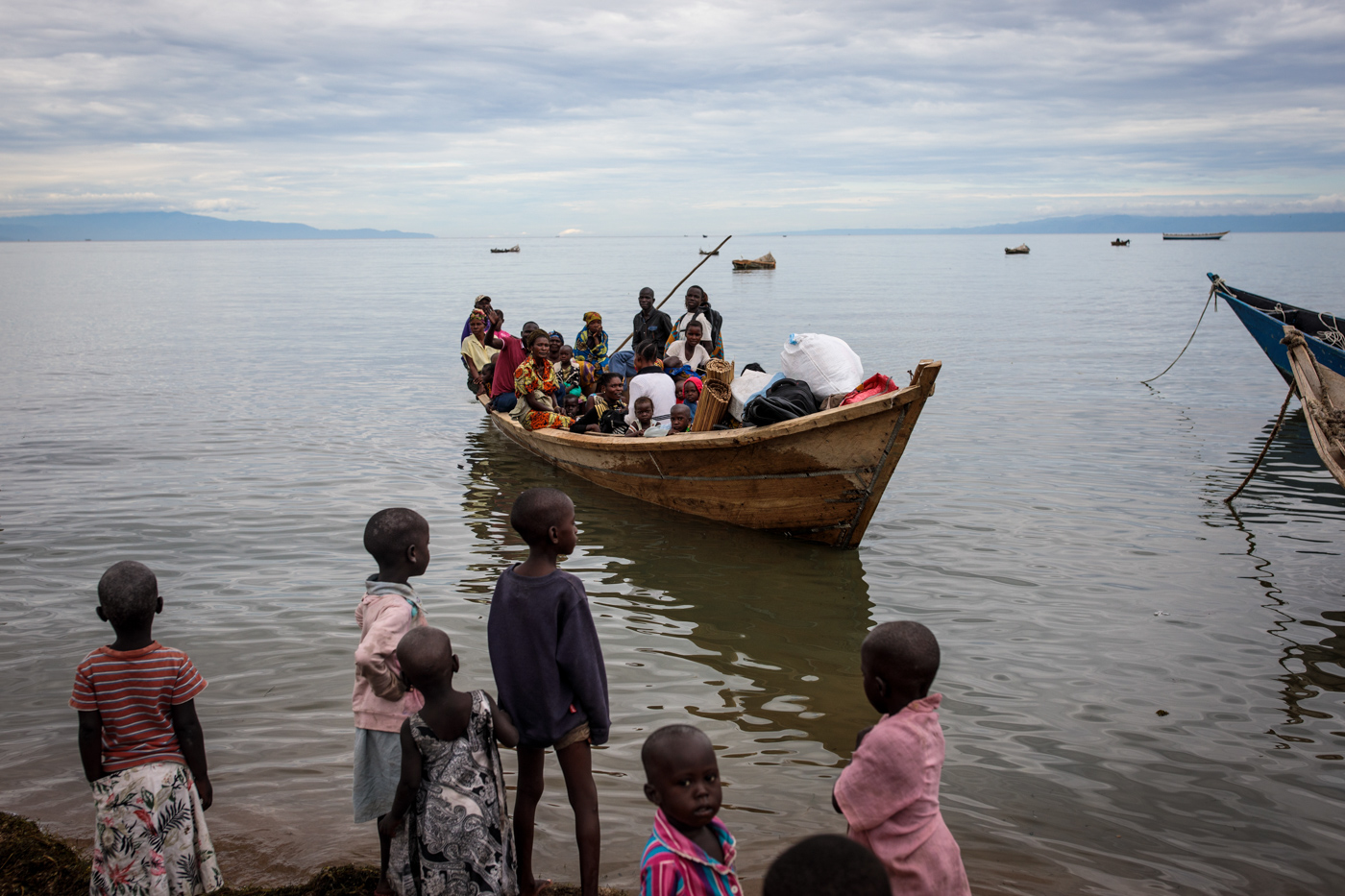 NSONGA, UGANDA: Refugees from Tchomia in the Democratic Republic of Congo arrive on boat at the Nsonga landing site on April 9, 2018.