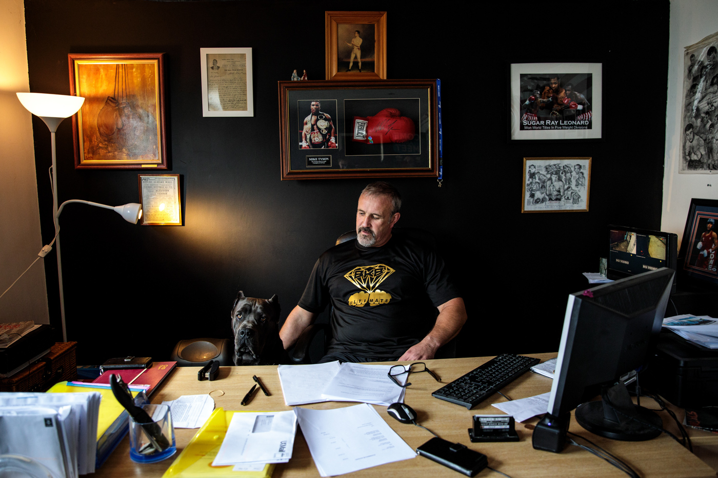 WARRINGTON, ENGLAND: Bare-knuckle boxing promoter and trainer Shaun Smith, 52, sits in his office next to his dog Drako after holding a training session at Smithys Gym on June 4, 2018 in Warrington, England.