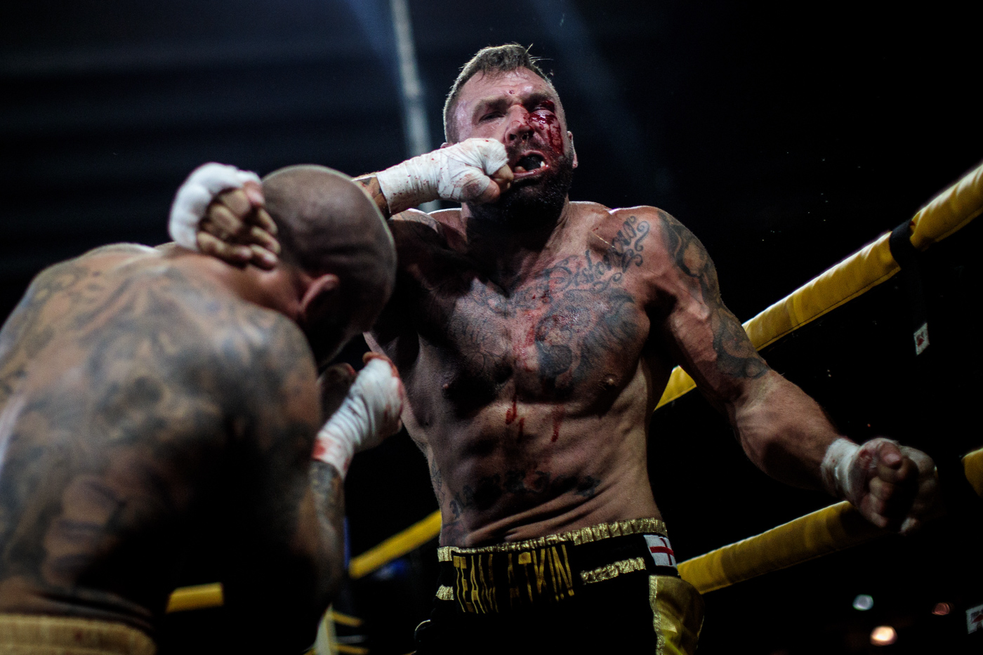 MANCHESTER, ENGLAND: Two-time World Bare-Knuckle Boxing Champion Luke Atkin, age 30 from York is hit by Dom Clark, 35 from Bournemouth during the Rogue Elite world title fight at an Ultimate Bare Knuckle Boxing (UBKB) event at Bowlers Exhibition Centre on August 4, 2018.