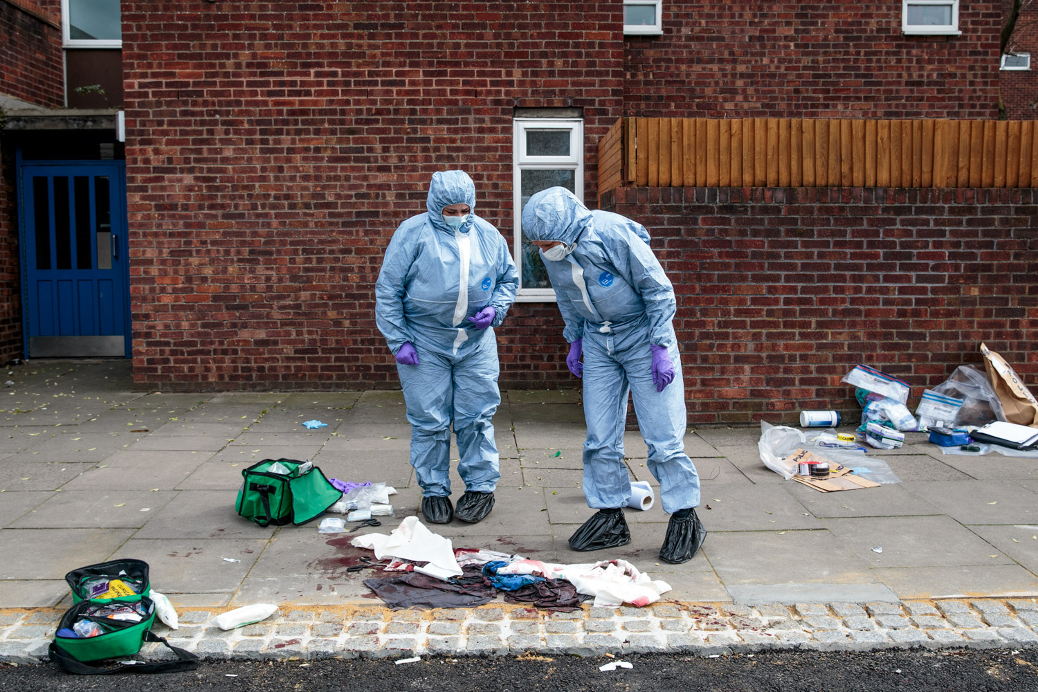 LONDON, ENGLAND: Forensics teams work at the scene of a stabbing in Edmonton on March 31, 2019.