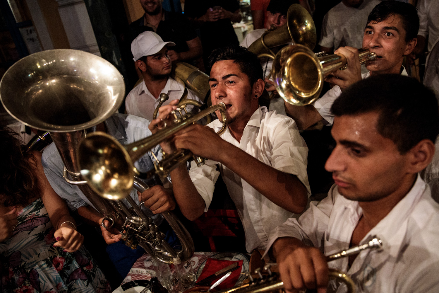 GUCA, SERBIA: A brass band performs in a restaurant during the Guca Trumpet Festival on August 11, 2017 in Guca, Serbia.