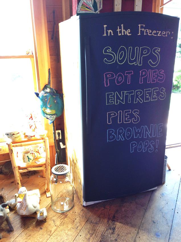{Homemade pies, brownie pops etc. I love that they painted the old fridge with chalkboard paint to spruce it up}