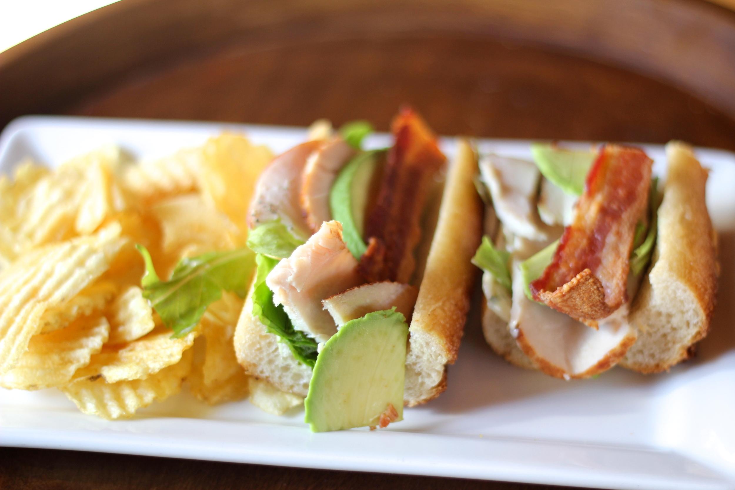 {Turkey, avocado, bacon, basil mayo sandwich}