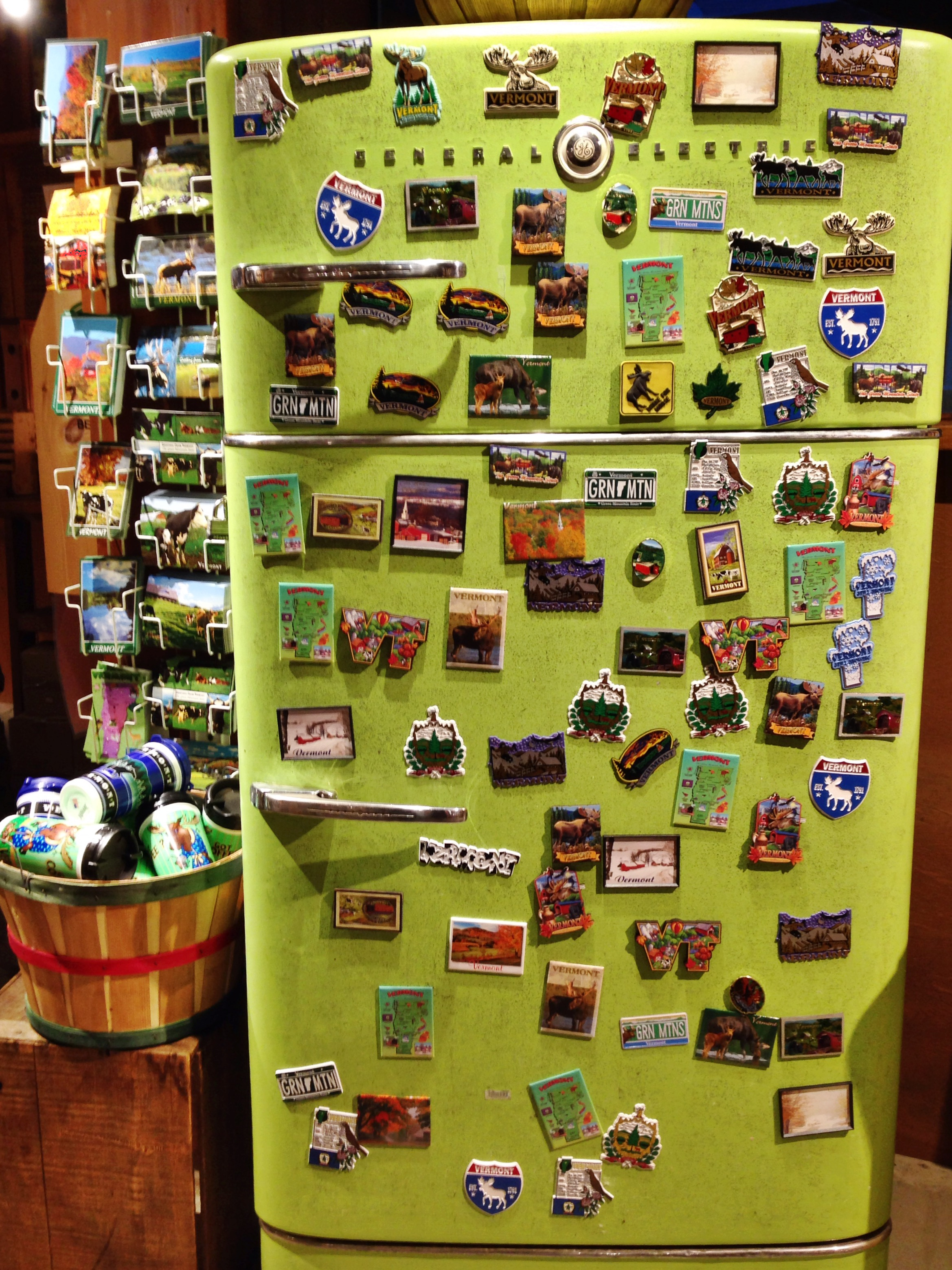 {Vermont magnets on an old green fridge}