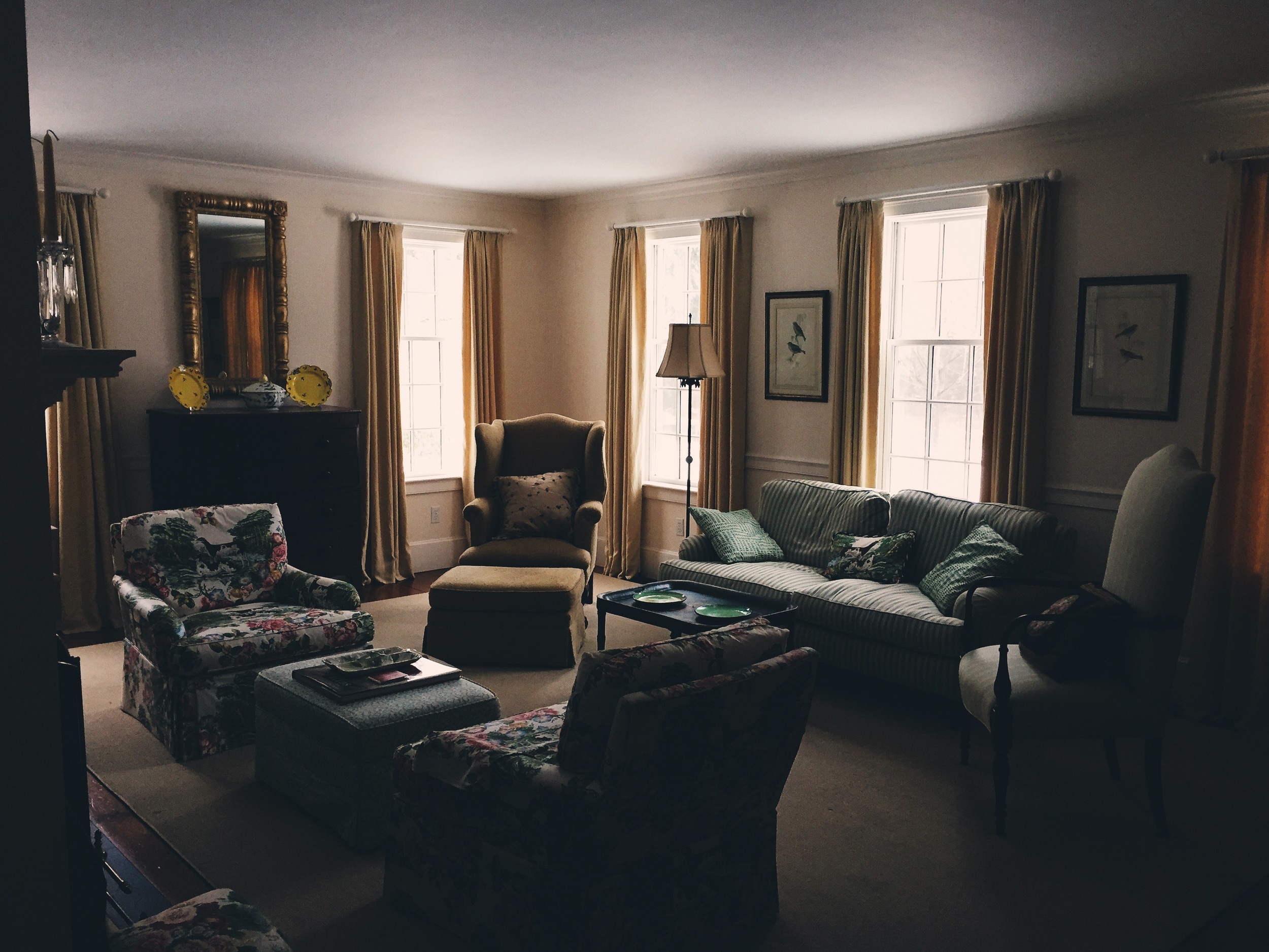 {A dimly lit, somewhat mysterious shot of our living room}