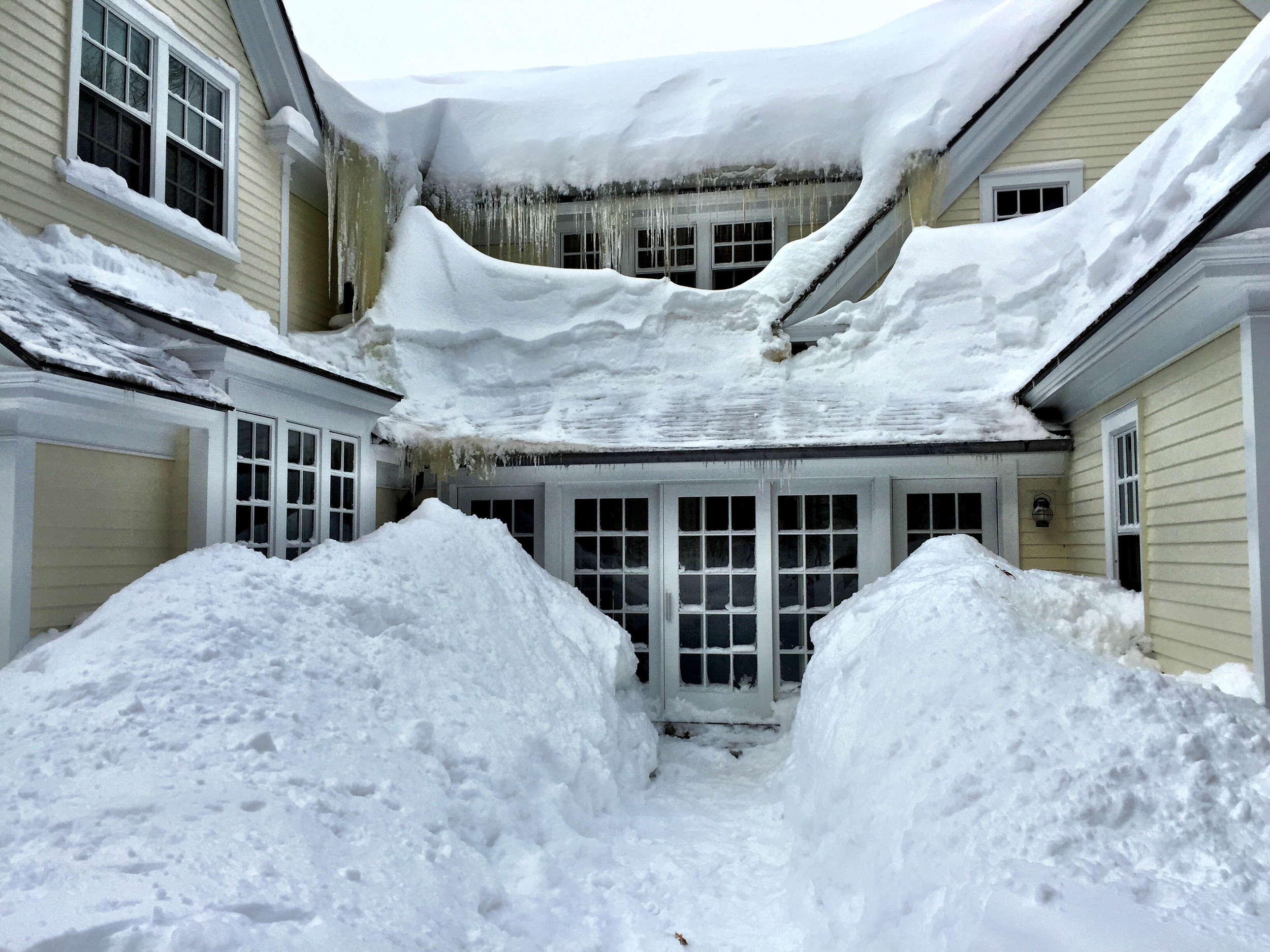 {Insane amounts of snow in our backyard...and many visibleattempts at roof raking}