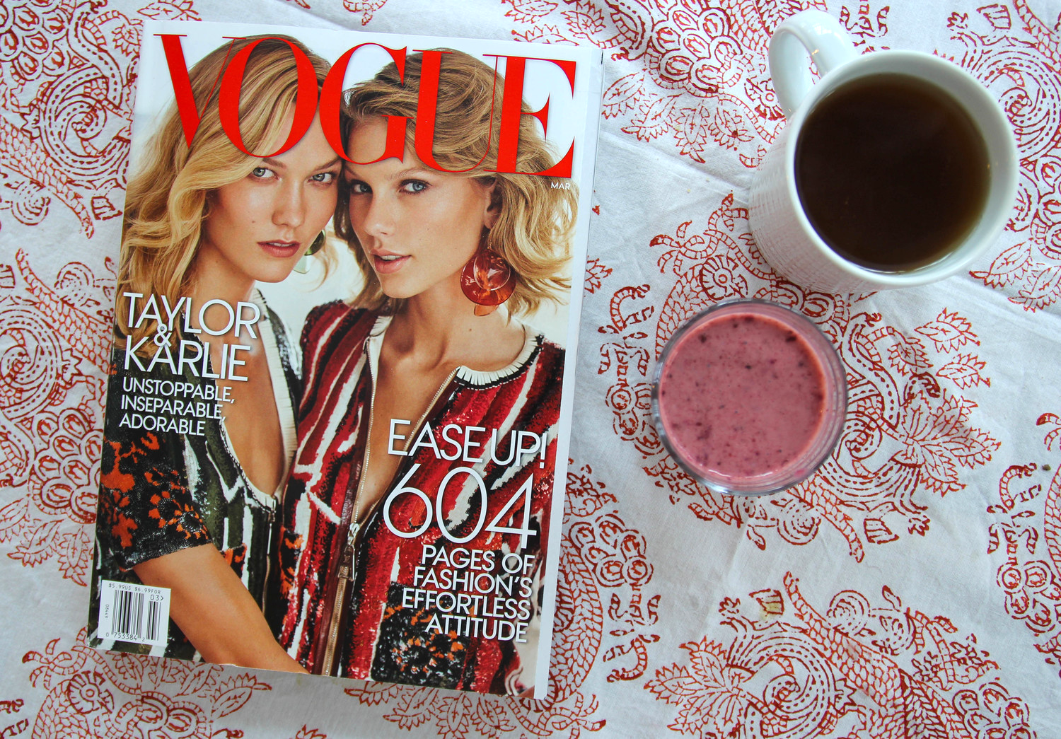 {Hydrating with green tea and a fruit smoothie while flipping through my new Vogue!}