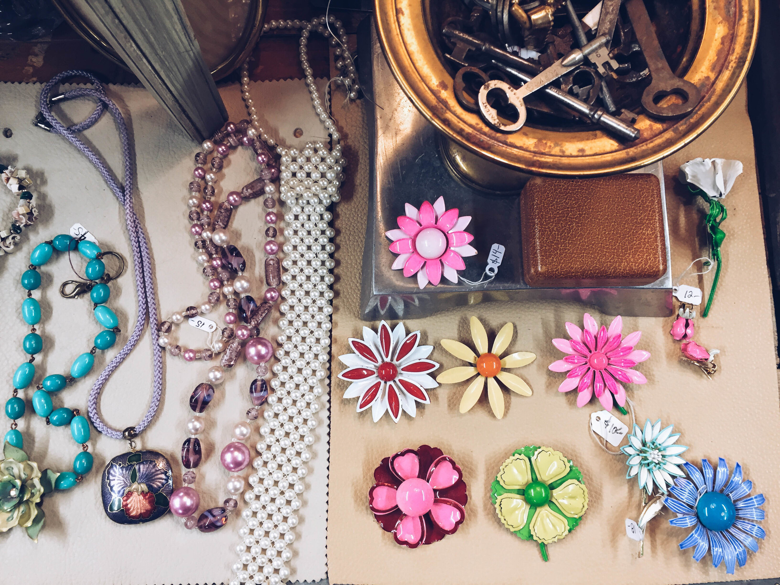 {Some pretty vintage flower pins from the SoWa vintage market}