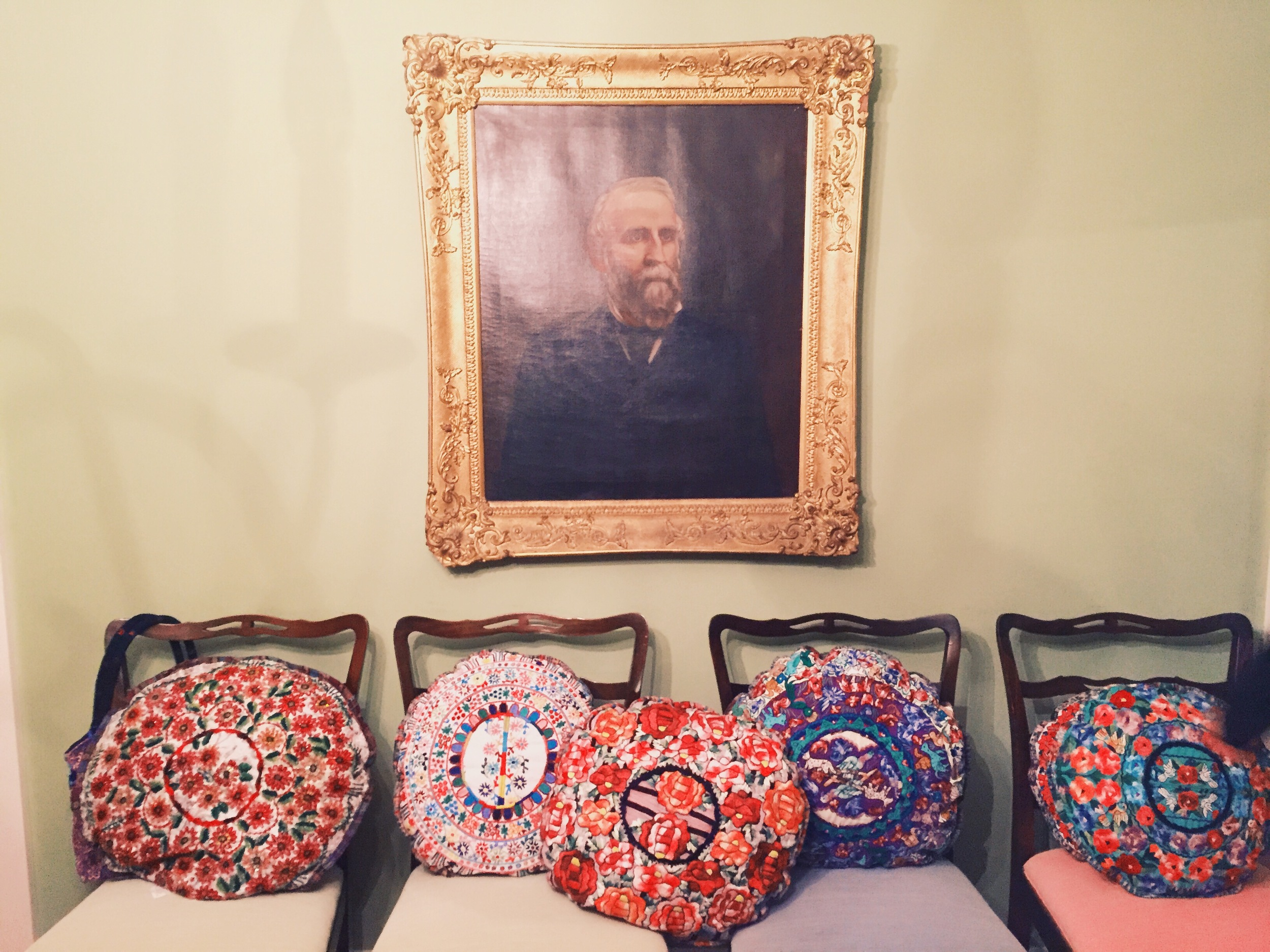 {A lovely holiday benefit for Mil Milagros last week featuring some GORGEOUS hand embroidered pillows}