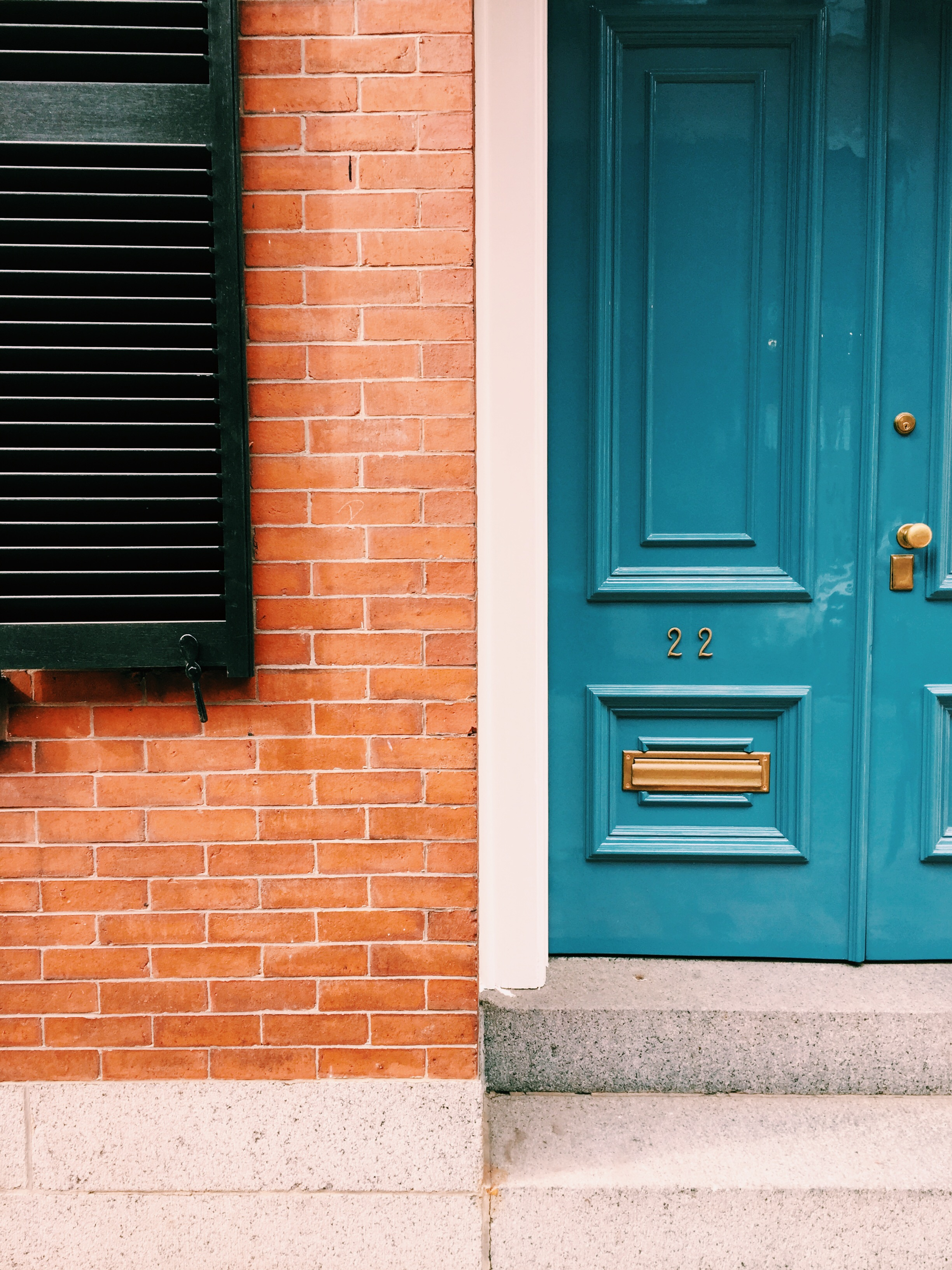 {A pretty blue door spotted on a walk around Beacon Hill}