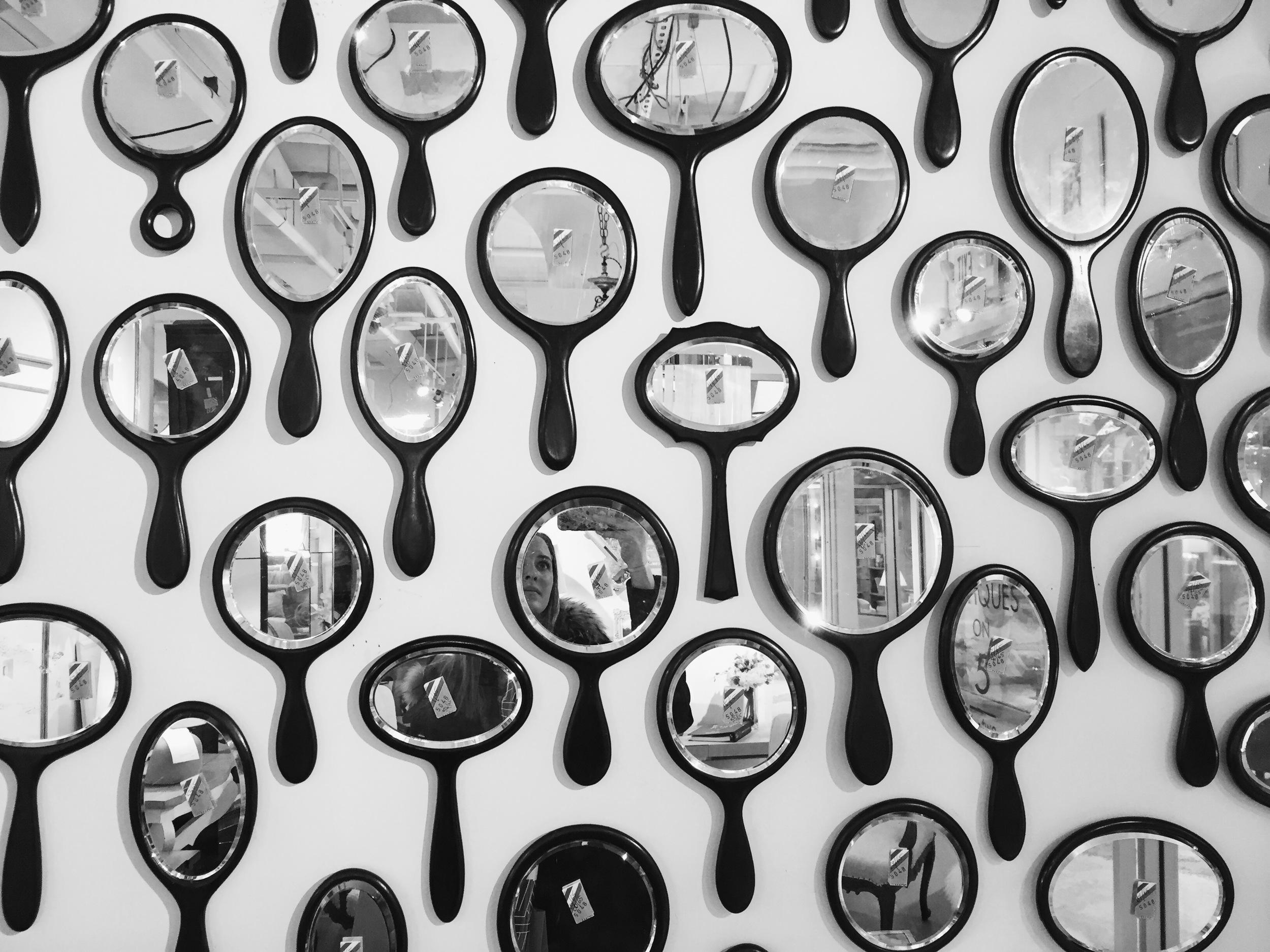 {I love this wall of mirrors at  Charles Spada }