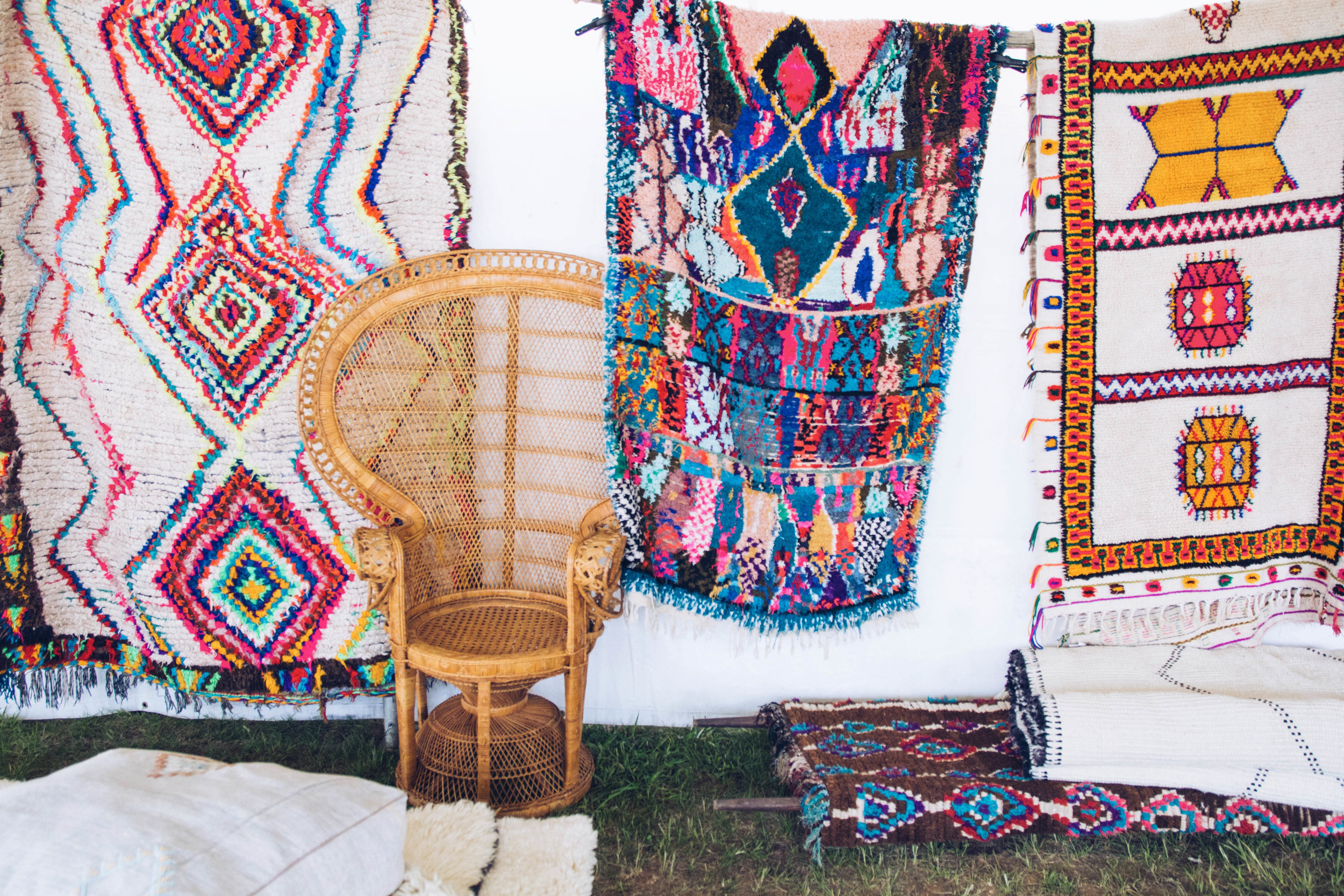 This vendor,  Heja Home , had gorgeous rugs, poufs, pillows and wicker chairs.