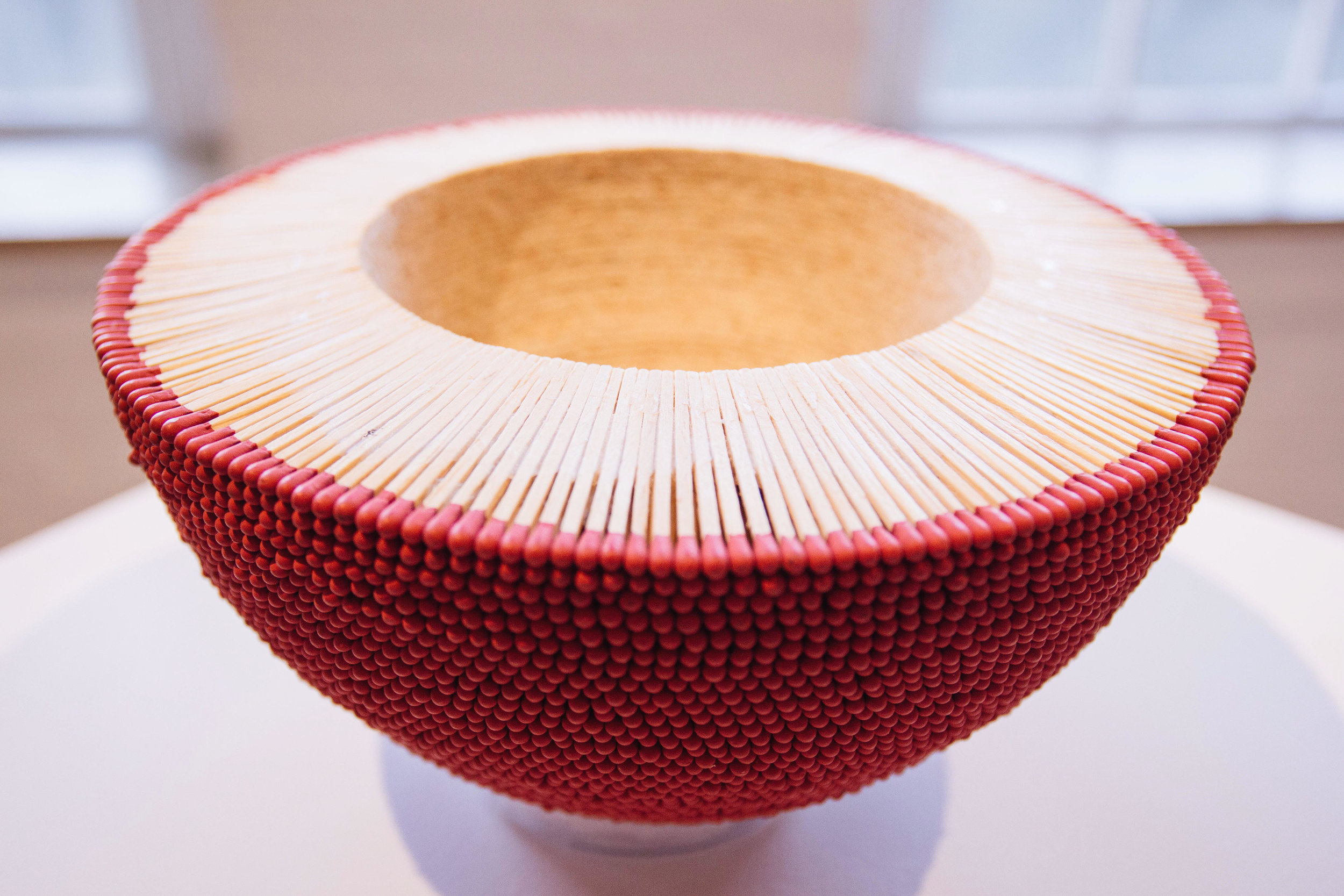 {This is a bowl made of matches! To be honest I was tempted to light it on fire to see what would happen...}