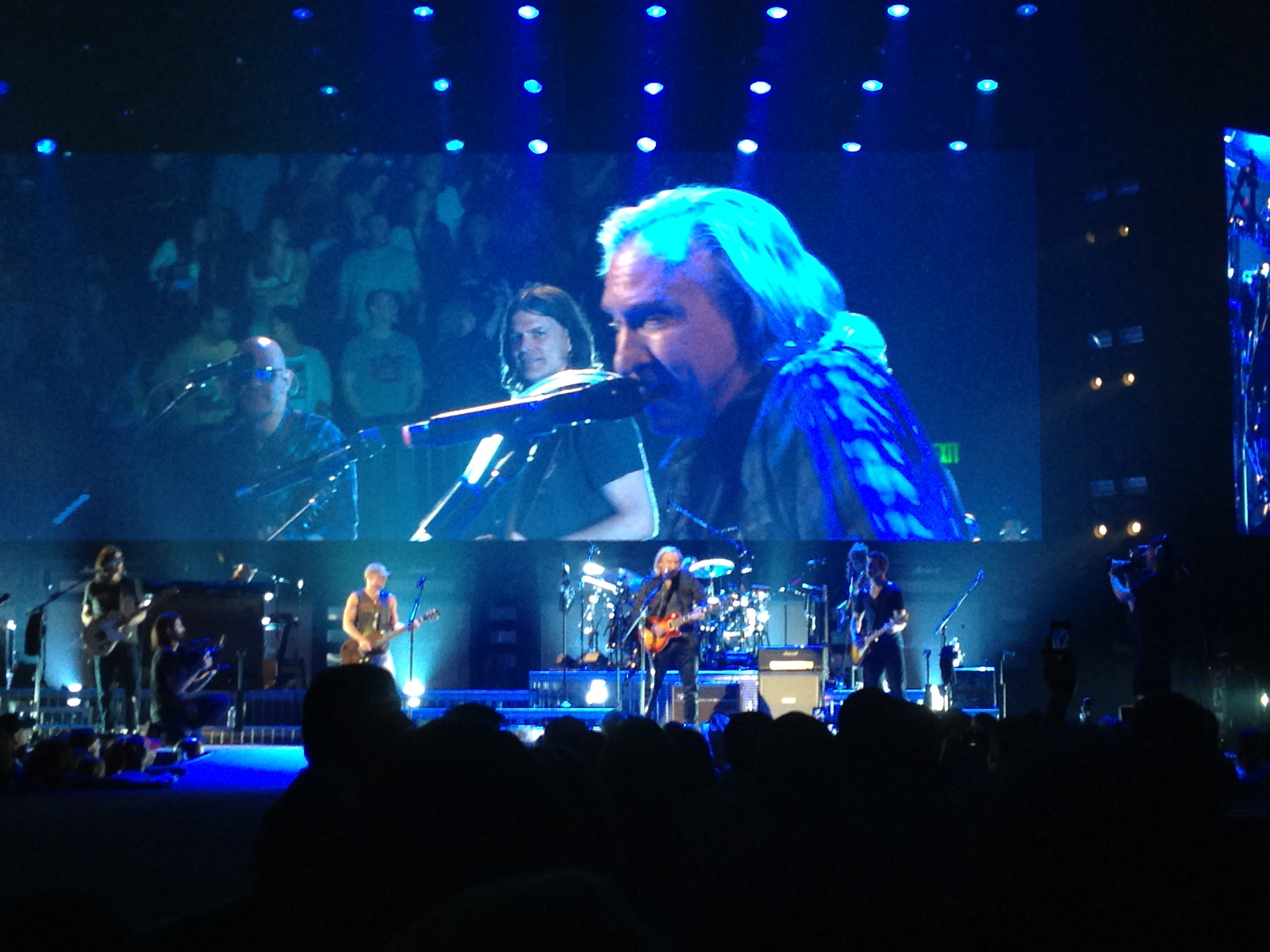 Joe Walsh using the talk box. he speaks through the tube and it goes through his guitar.