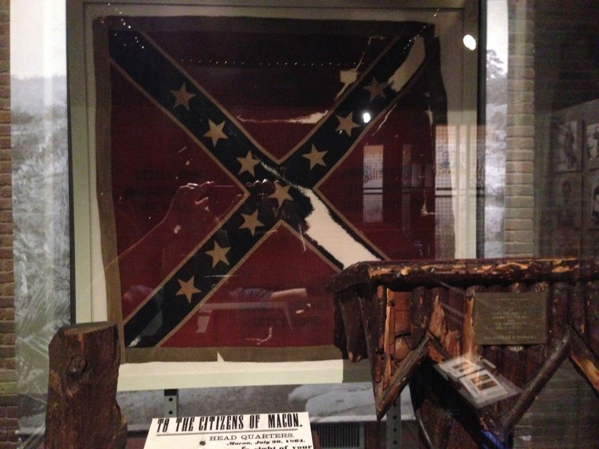 A Virginia Infantry Confederate flag, and a crudely made pulpit from the war.