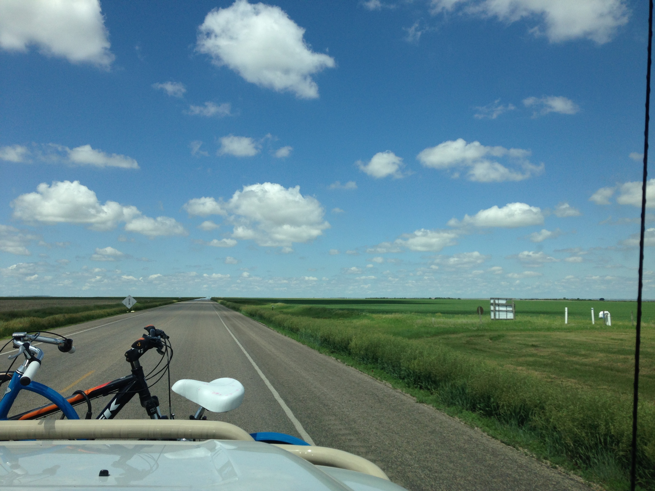 Wide open spaces! The windshield tones out the brilliant blue sky.