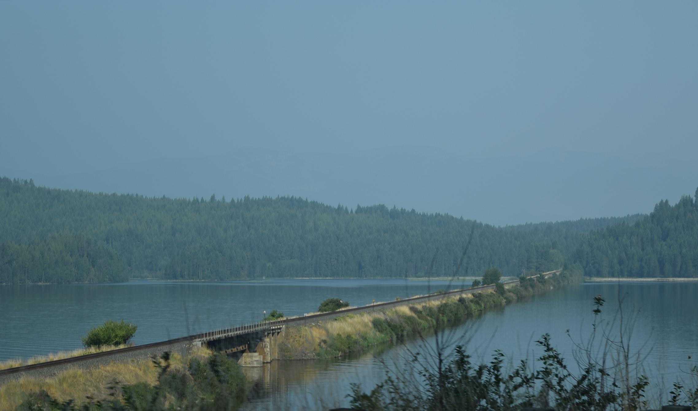 Train tracks crossing part of Pend Oreille Lake, Idaho. It'sa huge lake!
